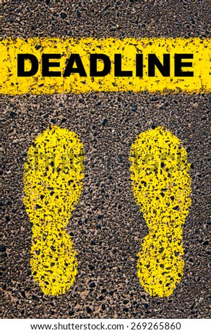 Deadline message. Conceptual image with yellow paint footsteps on the road in front of horizontal line over asphalt stone background. - stock photo