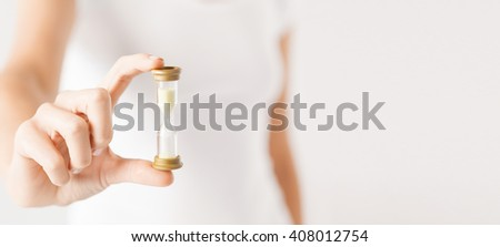 deadline, time management concept - close up of woman hand holding hourglass. - stock photo