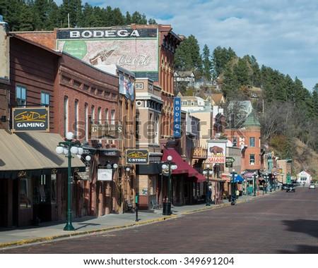 DEADWOOD, SOUTH DAKOTA - NOVEMBER 1: Historic downtown on Lower Main Street on November 1, 2015 in Deadwood, South Dakota  - stock photo