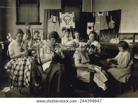 Deaf-mute girls sewing and darning in a training school in Sulphur, Oklahoma. April 1917 photo by Lewis Hine.