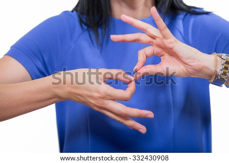 Deaf woman using sign language, close up, isolated on white - stock photo