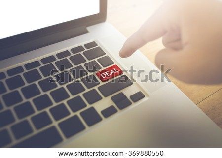 Deal word and Man hand press the button. - stock photo