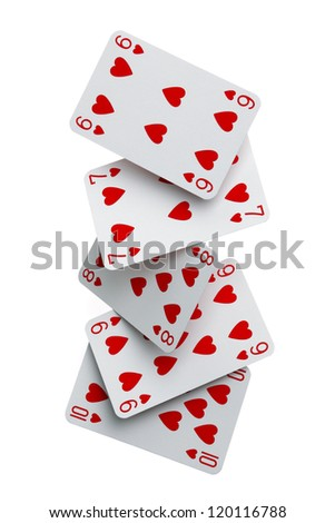 Dealing a straight flush of cards falling to the ground - stock photo
