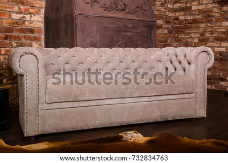 Dear, Gray Chesterfield Sofa. Living Room With Brick Walls, Home Interior
