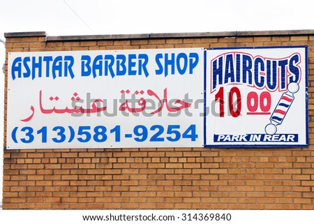 DEARBORN, MICHIGAN-AUGUST, 2015:  Sign for a barber shop, written in both English and Arabic.