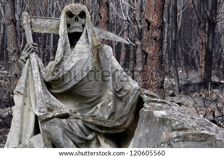 Death personified as a skeleton with a cloak and scythe with damaged forest in background - stock photo