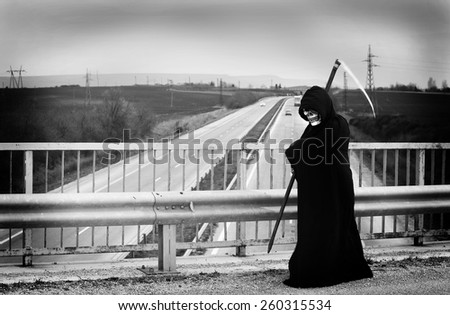 Death roams on the highway - stock photo