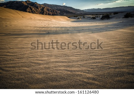 Death valley look into desert sand dunes before devils korn field - stock photo