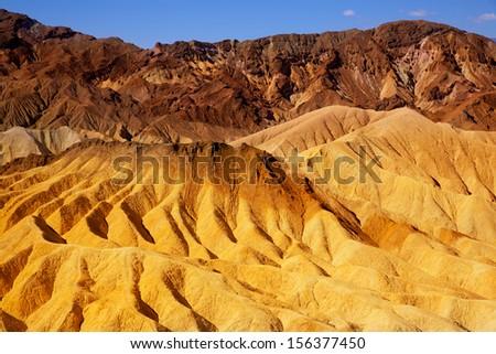 Death Valley National Park California Zabriskie point eroded mudstones - stock photo