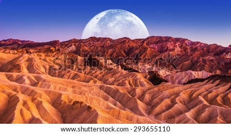 Death Valley Scenic Night. Death Valley National Park Badlands Sandstones Landscape and the Moon. California, United States. - stock photo