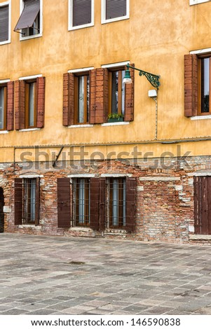 Deatil of an house's wall in Venice, Italy - stock photo