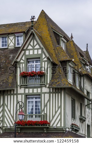 DEAUVILLE - JULY 18: Fragments of Anglo-Norman design of Normandy Barriere hotel on July 18, 2012, Deauville, France. 5 star hotel has English country-house design with dovecotes, turrets and gables. - stock photo