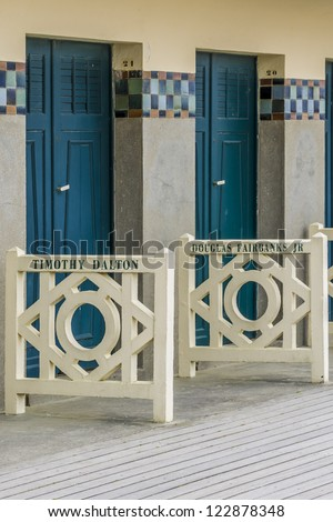 DEAUVILLE - JULY 18: Original beach closet on Promenade des Planches on July 18, 2012, Deauville, France. They are dedicated to actors and movie makers who participated in Film Festival of Deauville. - stock photo
