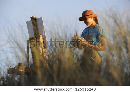 Debra Hilditch,landscape painter on location in the Kalahari desert, South Africa
