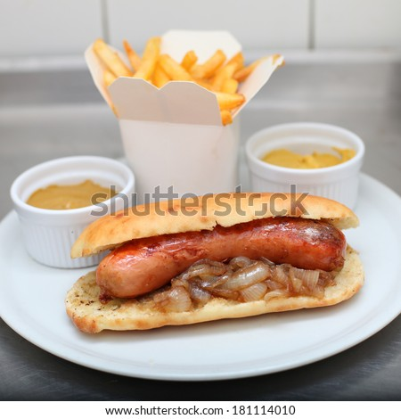 Debrecen sausage, hot dog with french fries and mustard sauce on plate, fast food menu  - stock photo