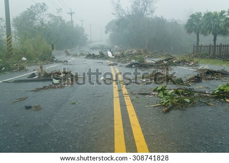Debri blocking road during a typhoon - stock photo