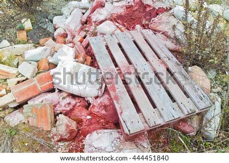 Debris heap after the demolition of a brick building - stock photo