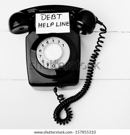 Debt help line - stock photo