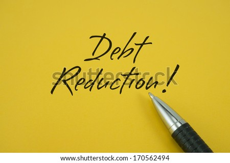 Debt Reduction! note with pen on yellow background