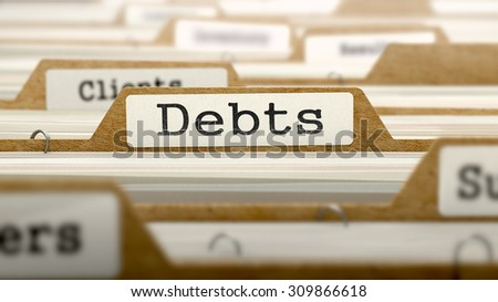 Debts Concept. Word on Folder Register of Card Index. Selective Focus.