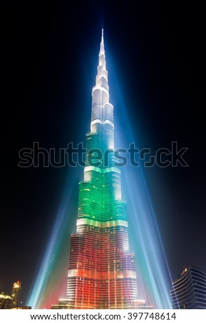 DEC 03 -DUBAI, UAE:  Burj Khalifa Tower is illuminated  in white, green and red colours of the flag of UAE to celebrate the 42nd National Day. on the third of december,2013 in Dubai,UAE. - stock photo
