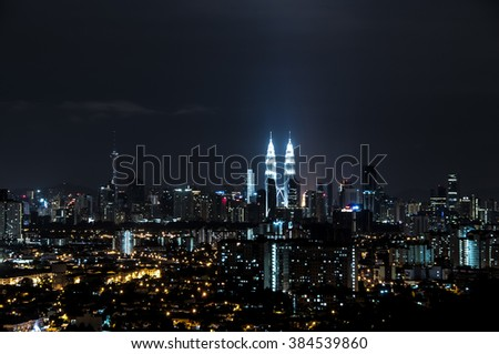 DEC 5, 2015 - Kuala Lumpur : The night scape of kuala lumpur. the long exposure shot cause the motion and soft focus to the clouds.