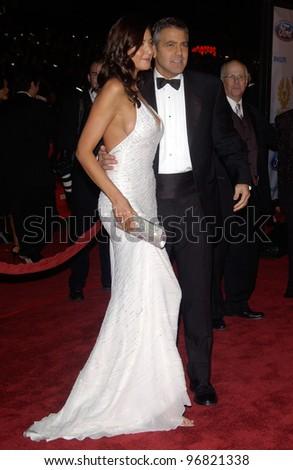 Dec 8, 2004; Los Angeles, CA: Actor GEORGE CLOONEY & girlfriend actress/model LISA SNOWDON at the Hollywood premiere of his new movie Ocean's Twelve. - stock photo