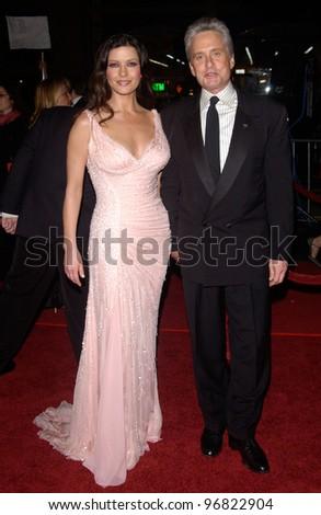 Dec 8, 2004; Los Angeles, CA: Actress CATHERINE ZETA-JONES & husband actor MICHAEL DOUGLAS at the Hollywood premiere of her new movie Ocean's Twelve. - stock photo
