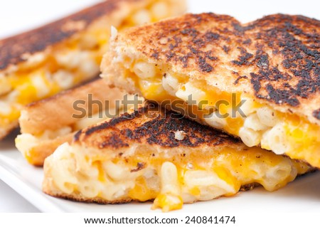 decadent mac & cheese sandwich with white and orange cheeses - stock photo