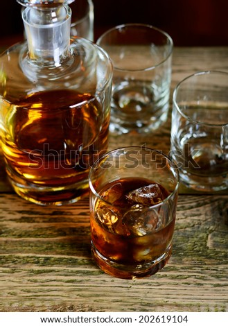 Decanter and glass of whisky - stock photo