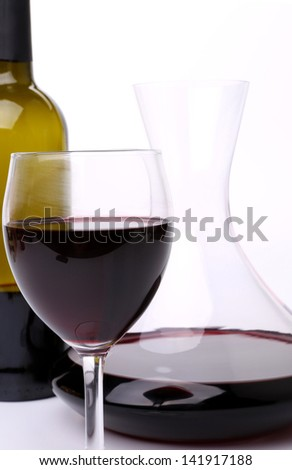 Decanter, bottle and glass of wine on the white bakground - stock photo