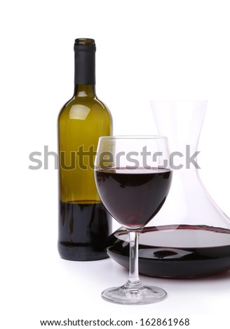 Decanter bottle and glass with red wine. Isolated on a white background - stock photo