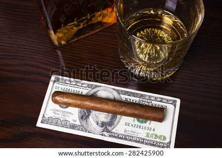 Decanter of whiskey and a glass with cuban cigar
