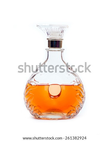 Decanter of whiskey on a white background - stock photo