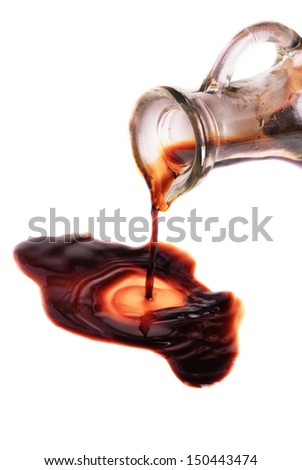 decanter with balsamic vinegar isolated on the white background  - stock photo