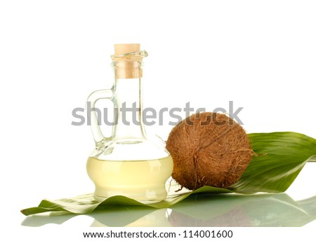 decanter with coconut oil and coconut isolated on white - stock photo