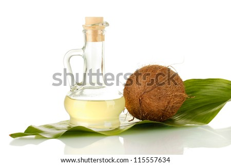 decanter with coconut oil and coconut isolated on white