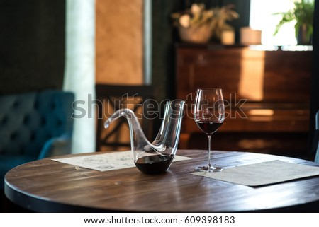 Nice Decanter With Red Wine And Glass On Wooden Table In Interior. Free Space  For Text