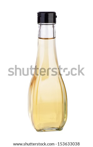 Decanter with white balsamic (or apple) vinegar isolated on the white background - stock photo