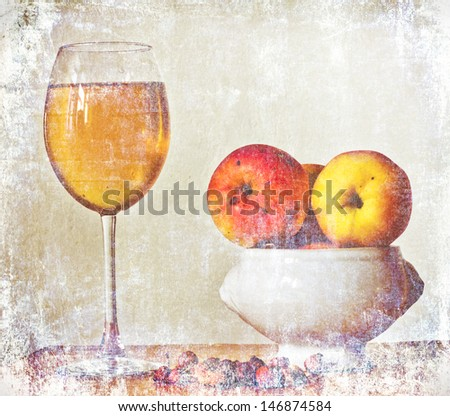 Decanter with wine and glass on a old stone background. - stock photo