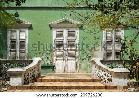 Decay of a beautiful colonial style house in Willemstad, Curacao. - stock photo