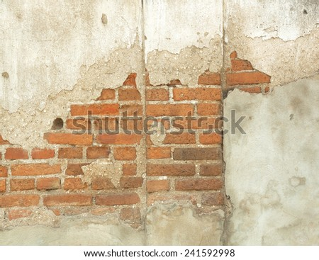 Decayed, cracked concrete vintage brick wall background. - stock photo
