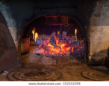 Decaying coals in Russian oven. In the Russian furnace. Grunge background.