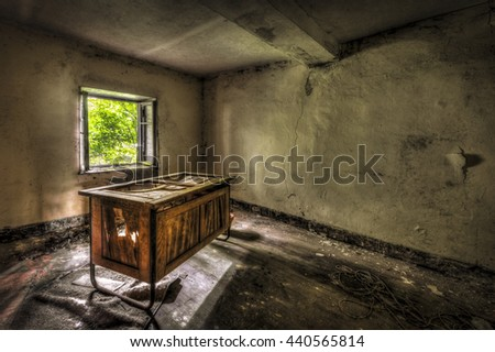Decaying desk in an abandoned office - stock photo