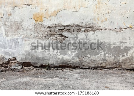 Decaying weathered cement brick wall with blank space for text.  - stock photo