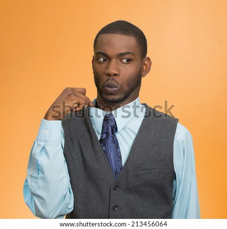 Deceiver. Portrait young business man opening shirt to vent, it's hot, unpleasant, awkward Situation, Embarrassment. Isolated orange background. Negative Emotion Face Expression, Feeling body language - stock photo