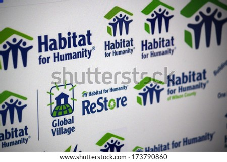 "DECEMBER 2013 - BERLIN: the logo of the Non Governmental Organization ""Habitat for Humanity"". - stock photo"