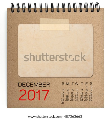 December 2017 calendar on brown notebook with old blank photo
