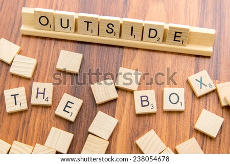 December 14, 2014 - Houston, Texas, USA - illustrative editorial of Scrabble tiles spelling OUTSIDE THE BOX