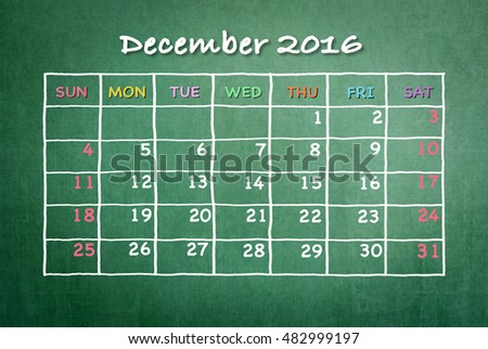 December 2016: Monthly calendar on green chalkboard background with colorful pastel day and date in freehand grid time table chalk drawing: School/ business time planner conceptual idea for new plan